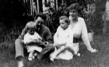 ADG - holding Dan, Arla Peabody Guion with Lad in her lap - 1917