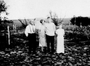 Peabodys, Uncle Rex, Aunt Ella, Russell and _______ Peabody, Deer Park, Wisc., Aug., 1934