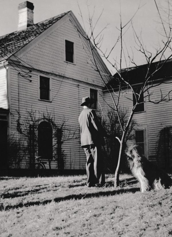 ADG - Grandpa with Smokey in yard - near Thanksgiving, 1945